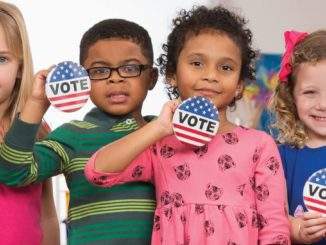 Image of children with voting badges